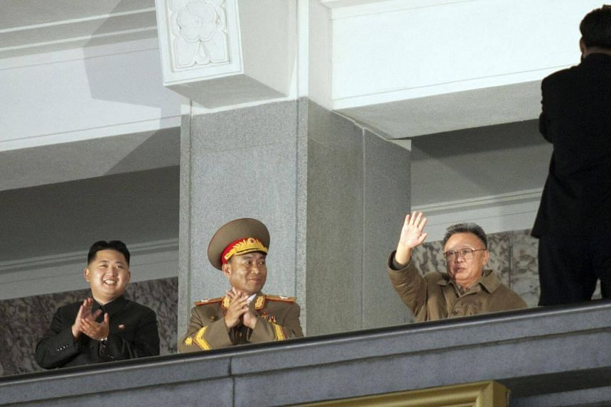 A file photo of North Korean Foreign Minister Ri Yong Ho (centre) with the late Kim Jong Il (right) and current North Korean leader Kim Jong Un.
