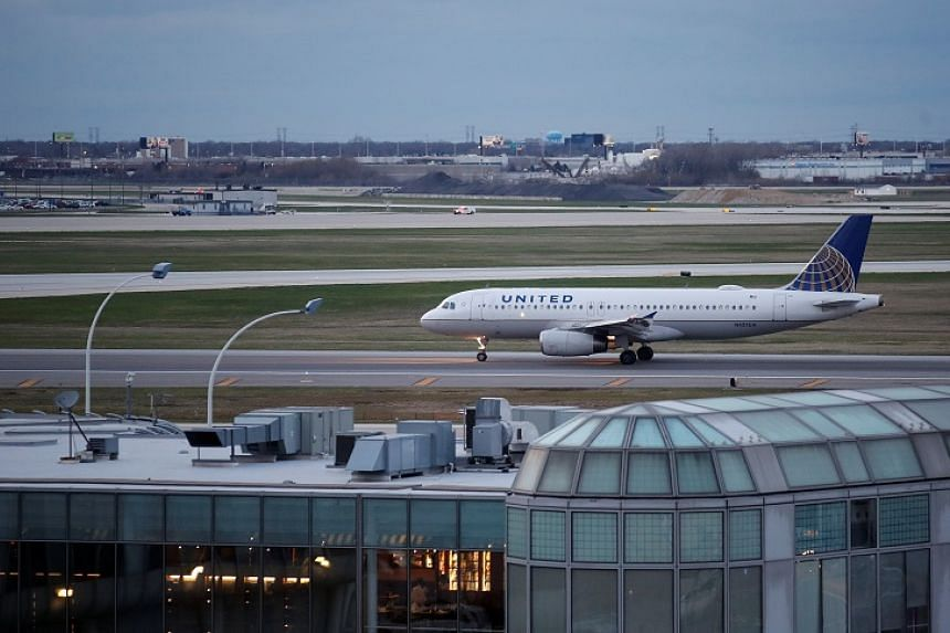 A United Airline Airbus A320 aircraft lands at O'Hare International Airport in Chicago, Illinois on April 11, 2017.