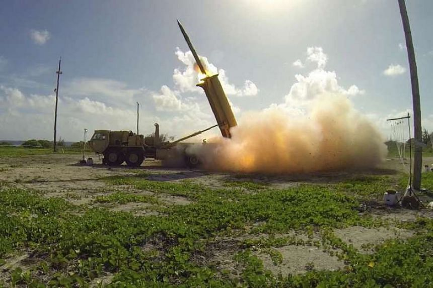 A Terminal High Altitude Area Defence (Thaad) interceptor is launched from a Thaad battery on an island in the Pacific Ocean.