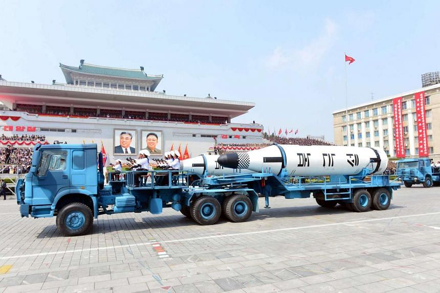 """Military vehicles carry missiles with characters reading """"Pukkuksong"""" during a military parade marking the 105th birth anniversary of country's founding father Kim Il Sung, in this undated photo."""