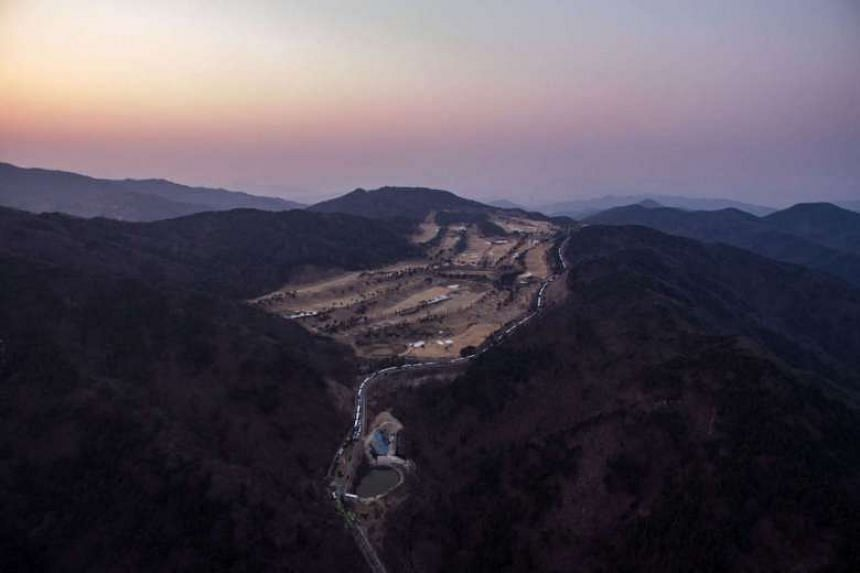 File photo of an aerial view of a golf course used as the site of a recently installed anti Terminal High Altitude Area Defense (Thaad) system in Seongju, on March 18, 2017.