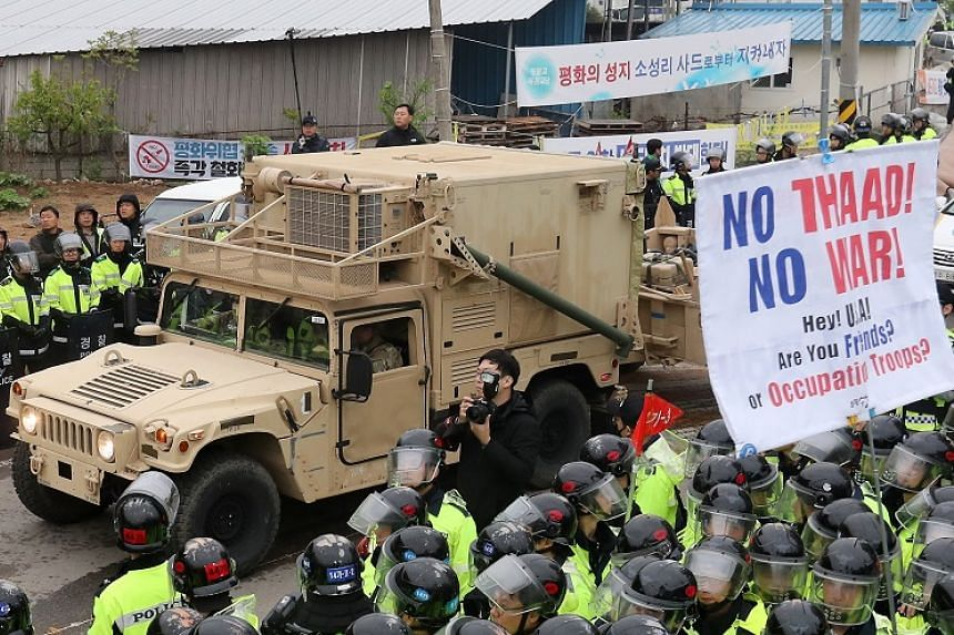 A US military trailer carrying elements of the Terminal High Altitude Area Defense (Thaad) system enters a golf course in Seongju, South Korea, April 26, 2017.
