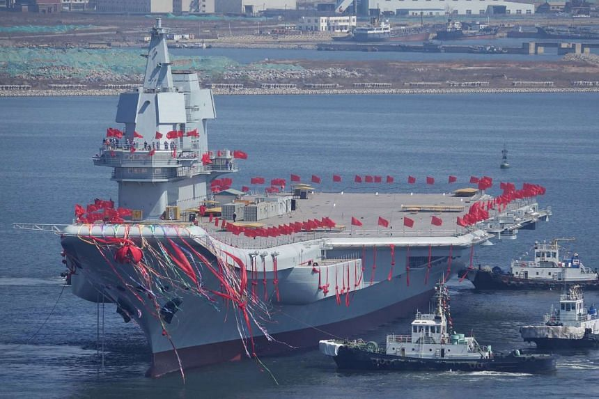 China's first domestically built aircraft carrier is seen during its launching ceremony in Dalian, Liaoning province, China, on April 26, 2017.