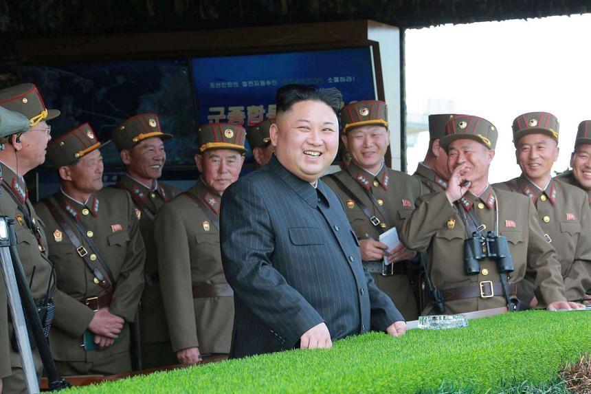 North Korean leader Kim Jong Un watches a military drill.