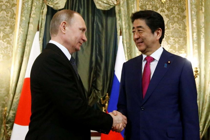 Putin shakes hands with Abe at the Kremlin in Moscow, April 27, 2017.