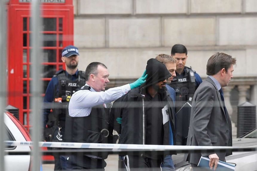 A man is led away by police in Westminster after an arrest was made on Whitehall in central London, Britain, April 27, 2017.