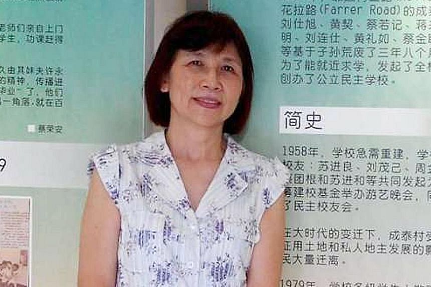 The scene of the accident at the carpark of Block 332, Ang Mo Kio Avenue 1. According to an eyewitness, Mr Quek Chin Ling did not seem to realise that his wife, Mrs Quek-Ng Siew Fong (above), had opened her car door and stepped out of the car. When M