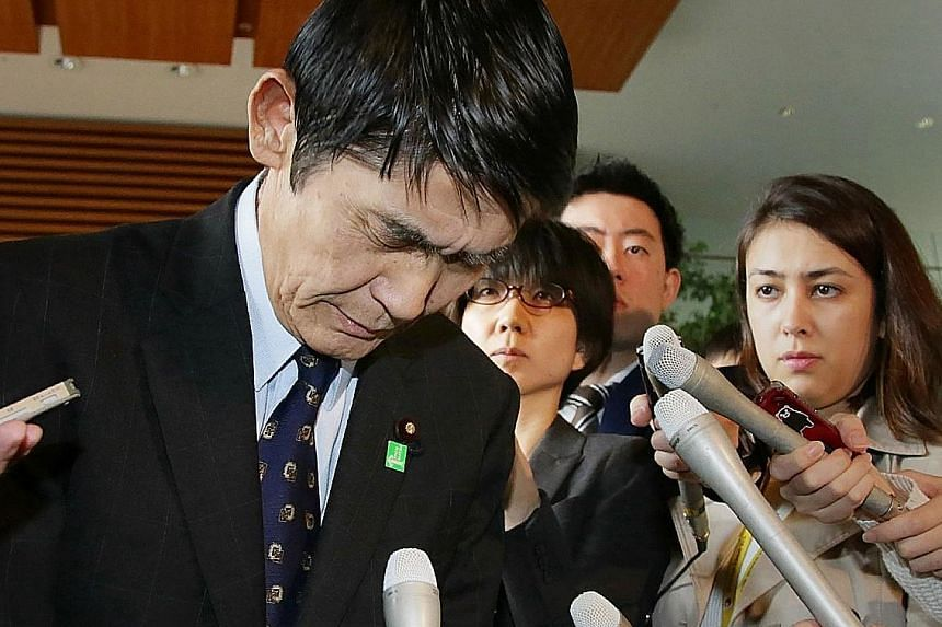 Japan's minister in charge of reconstruction of disaster-hit Tohoku region, Mr Masahiro Imamura, expressing regret yesterday for his remarks about the 2011 quake, which sparked outrage.