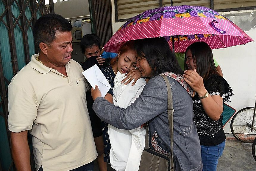 Ms Jiranuch Trirat, mother of the 11-month-old girl whose murder by her father was broadcast on Facebook, crying as she hugged her daughter's body at a hospital in Phuketon Tuesday. Netizens were outraged that the authorities in Thailand took so long