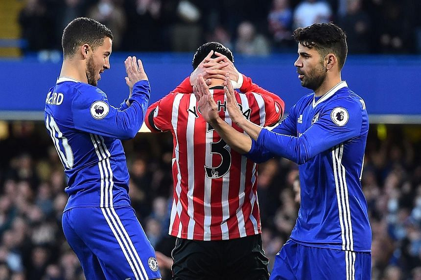 Chelsea midfielder Eden Hazard (left) celebrates his fifth-minute opener against Southampton with Diego Costa. The Spain striker provided the assist before scoring two goals of his own at Stamford Bridge.