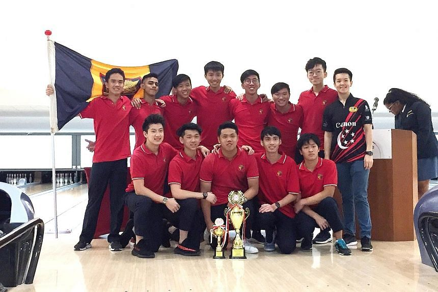 Anglo-Chinese Junior College's boys' bowling team celebrate capturing their fourth A Division title in five years with national bowler Shayna Ng, who handed the winners their trophies.