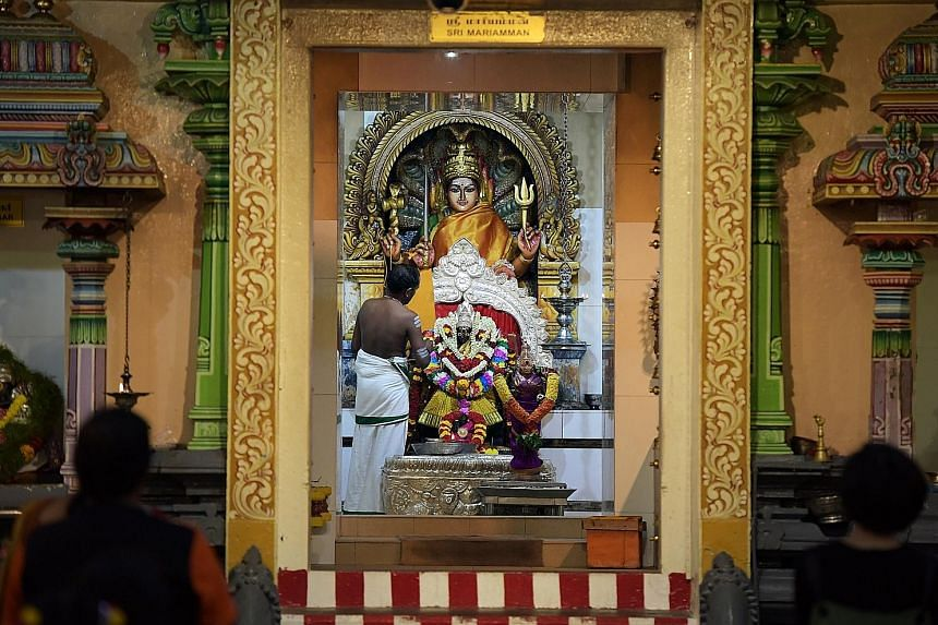 The 190-year-old Sri Mariamman Temple is popular with devotees and tourists alike, and is venerated by the local Hindu community. The main deity Mariamman (centre), who is believed to cure illnesses and epidemics, faces the entrance to the east, wher