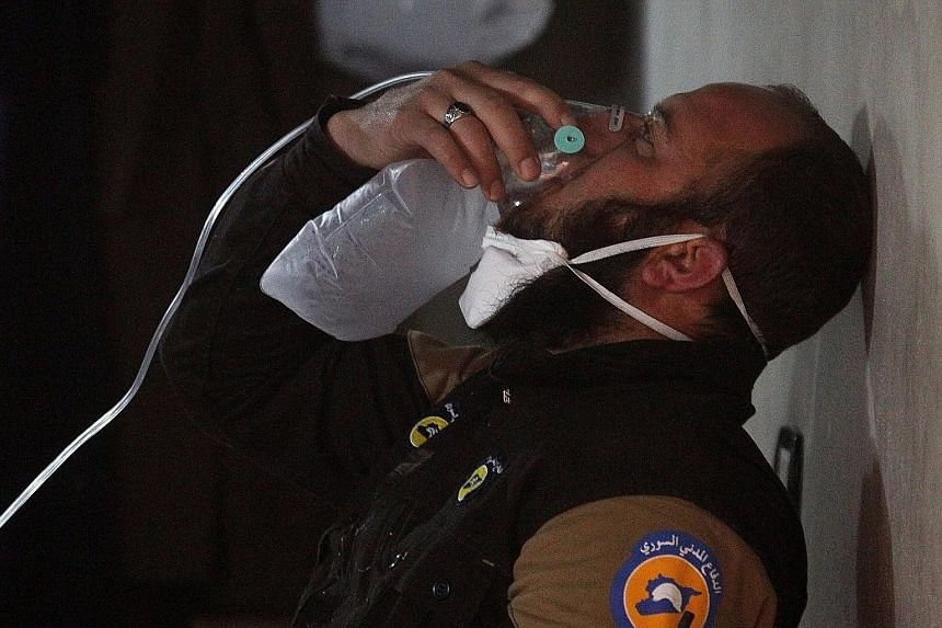 A Syrian civil defence member getting some oxygen after a suspected chemical weapons attack on Khan Sheikhoun on April 4. A French report says President Bashar al-Assad or members of his inner circle ordered it.