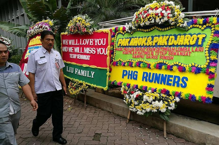 Flower stands with messages of gratitude for Basuki and his running mate Djarot Saiful Hidayat at City Hall yesterday.