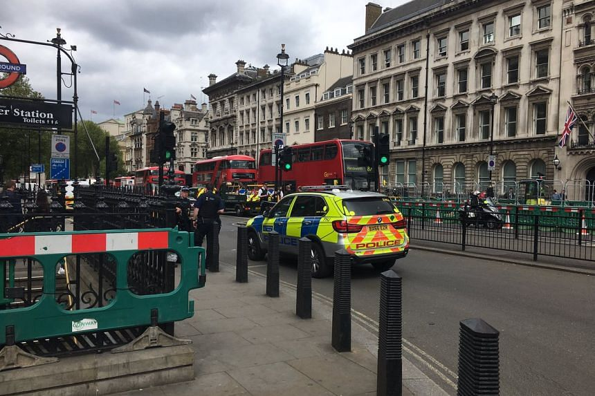 British police cars on the scene at Whitehall, where a man was arrested.