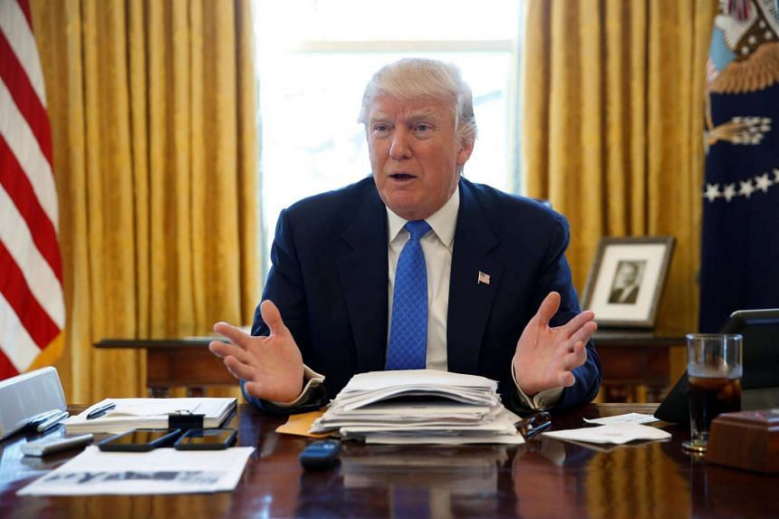 US President Donald Trump seen in a file photo taken on Feb 23, 2017 in the Oval Office at the White House in Washington.
