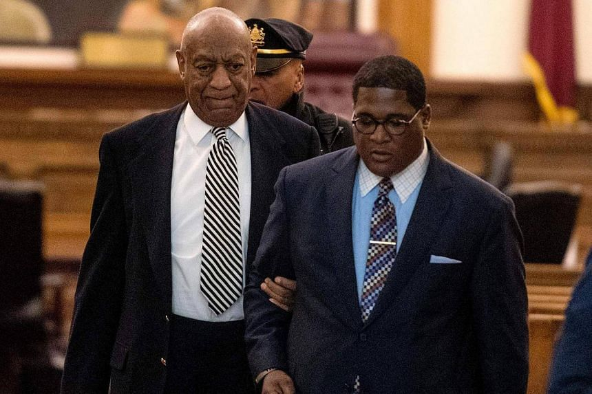 Actor Bill Cosby (left) is escorted outside Montgomery County Courtroom on April 3, 2017 in Norristown, Pennsylvania.