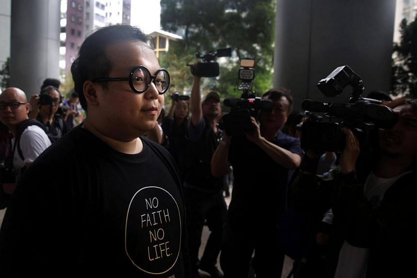 Derek Lam was the only activist so far to emerge from the police station Thursday morning (April 27).