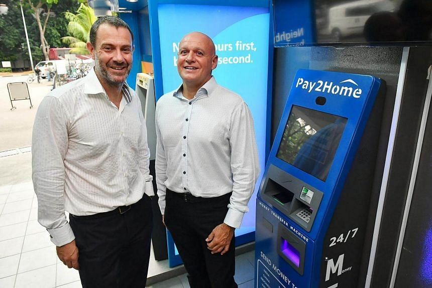Pay2Home Group directors Wayne Salamonsen (left) and David Hulme with the Money Transfer Machine at Averic Woodlands Dormitory.