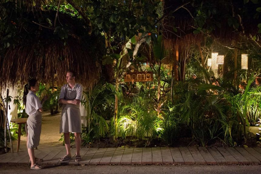 : A sand trail leads to the dining area of Noma Mexico, a seven-week pop-up restaurant in Tulum, Mexico. PHOTO: JENNIFER CHASE FOR WASHINGTON POST