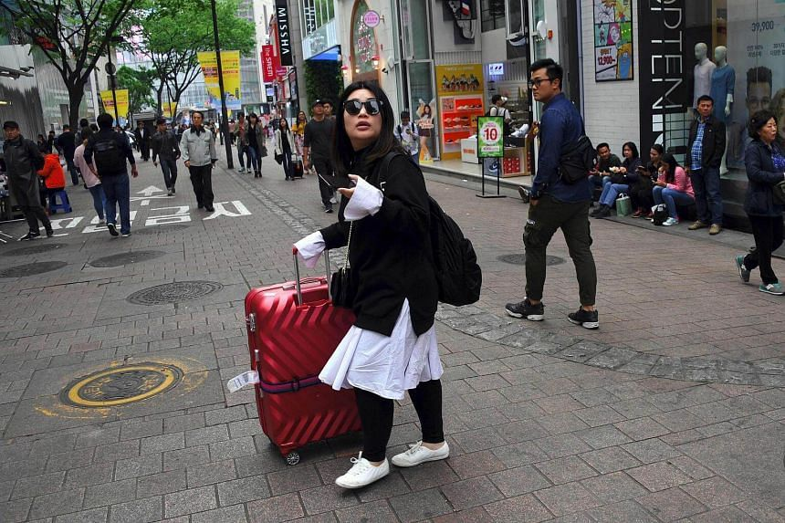 Beijing has imposed curbs on goods and services from South Korea, as well as Chinese tours to the country.
