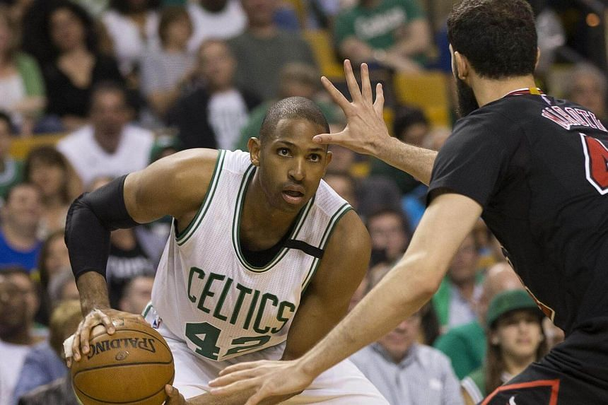 Boston Celtics' Al Horford (left) looking to get by Chicago Bulls' Nikola Mirotic in their NBA Eastern Conference game in Boston on April 16, 2017.