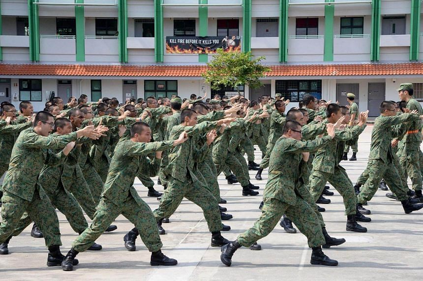 National Service recruits demonstrating hand-to-hand combat moves on Pulau Tekong on Feb 7, 2017.