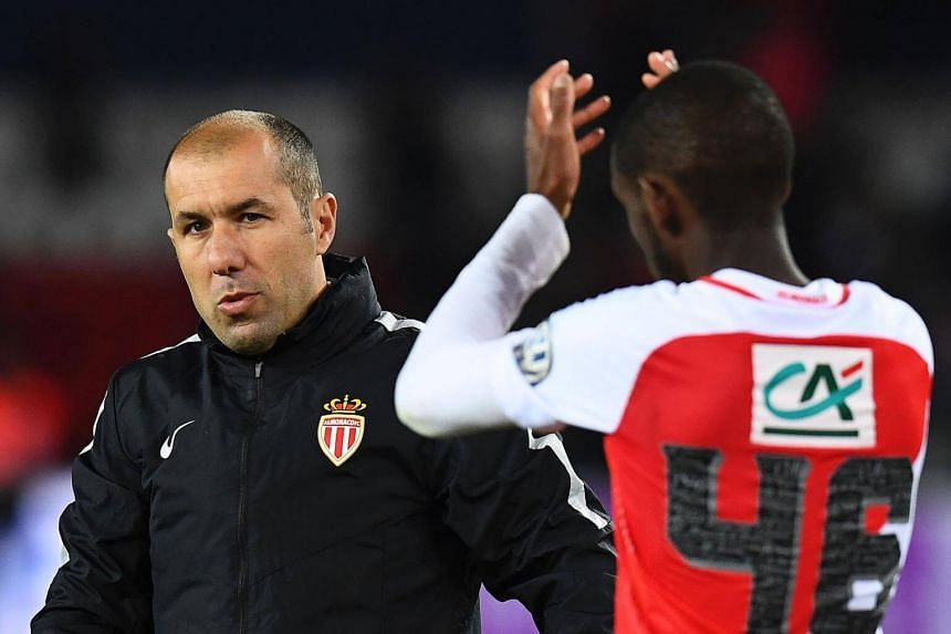 Monaco's Portuguese coach Leonardo Jardim (left) reacts at the end of the French Cup semi-final match between Paris Saint-Germain and Monaco at the Parc des Princes stadium in Paris on April 26, 2017.