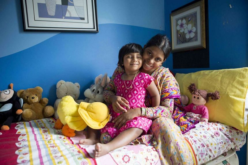 This undated handout photo released on April 28, 2017 by the Children First Foundation shows three-year-old Choity Khatun (left) with her mother Shima (right) in hospital in Melbourne after she had life saving reconstructive surgery.