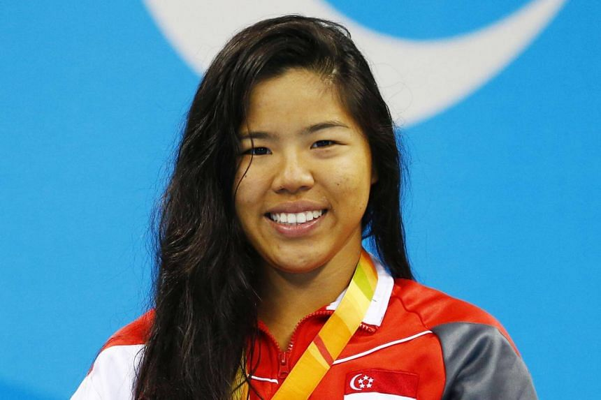 Singapore Para-swimmer Yip Pin Xiu with her gold medal after winning at the 2016 Paralympic Games in Rio de Janeiro, Brazil.