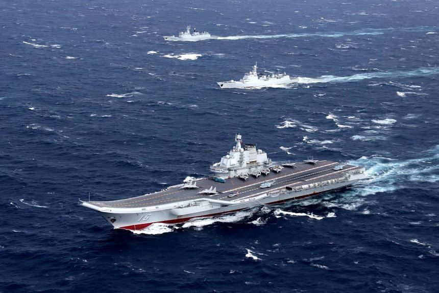 A file photograph of China's Liaoning aircraft carrier with accompanying fleet conducting a drill in an area of South China Sea.