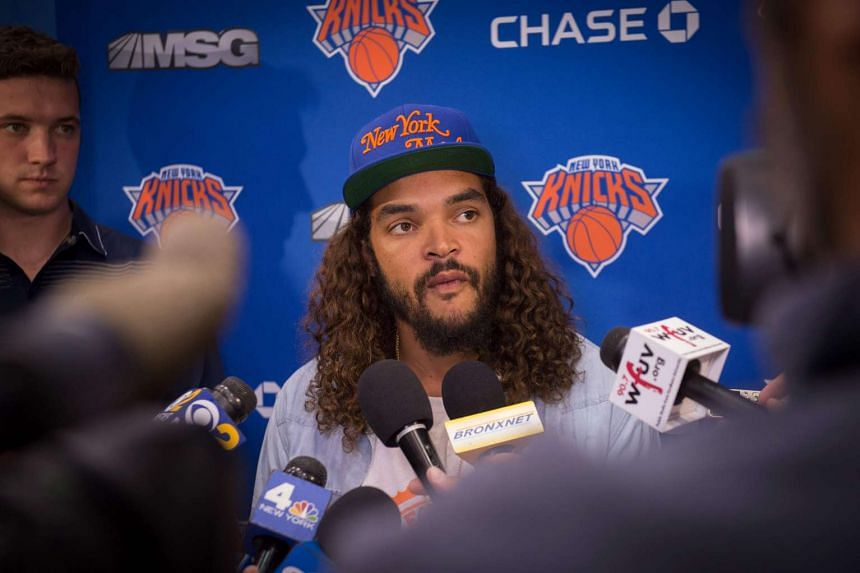 Noah speaking with the media after joining the Knicks, in July 2016.