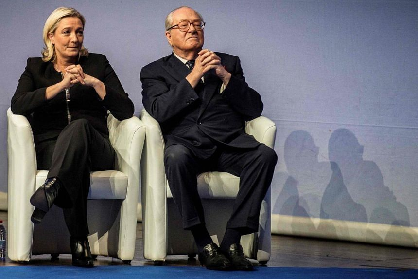 Marine Le Pen (left) expelled her father, Jean-Marie Le Pen, from the National Front party two years ago.  Here, they are listening to a speech in Lyon, during the 15th French far-right National Front congress on Nov 29, 2014.