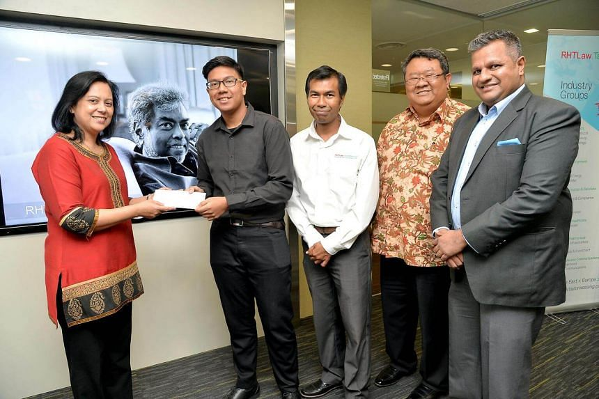 Muhammad Irman Abdul Aziz (second from left), an ITE student, is one of the five students to receive the RHT Subhas Anandan Bursary Award.