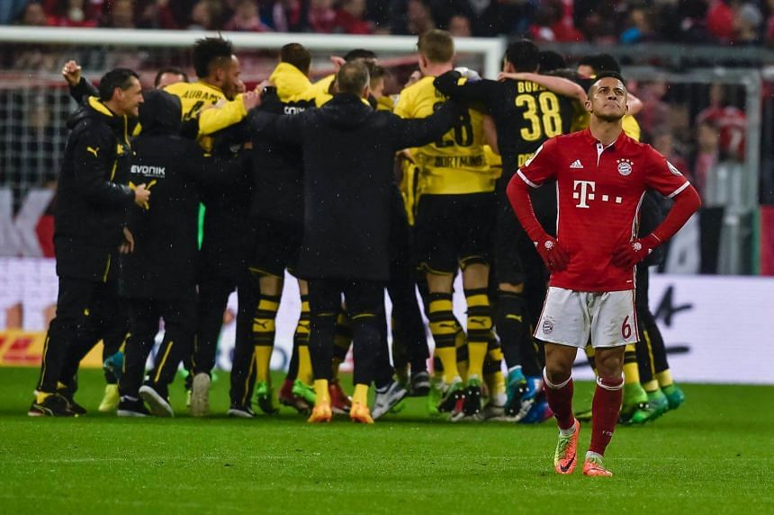 Bayern Munich's Spanish midfielder Thiago Alcantara reacts after the German Cup DFB Pokal semifinal football match between FC Bayern Munich and BVB Borussia Dortmund in Munich, on April 26, 2017.