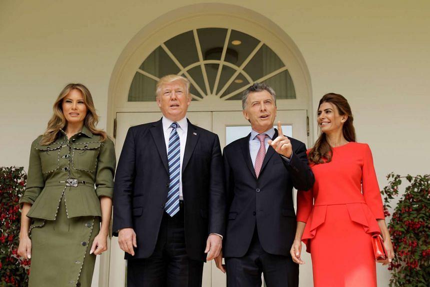Trump and wife Melania welcome Macri and wife Juliana to the White House.