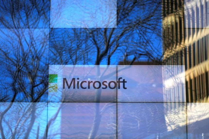 An advertisement is played on a set of large screens at the Microsoft office in Cambridge, Massachusetts.