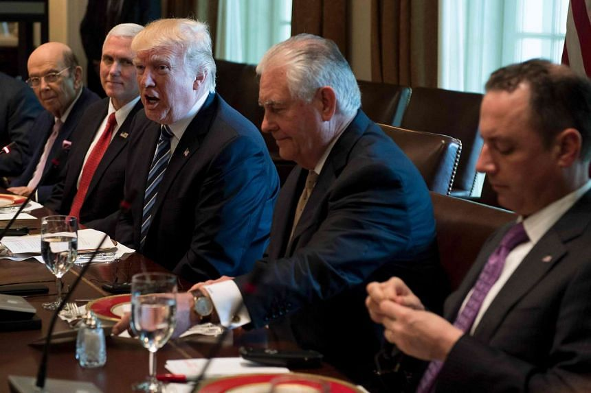 US Secretary of State Rex Tillerson (second from right) at a lunch with US President Donald Trump, April 27, 2017.