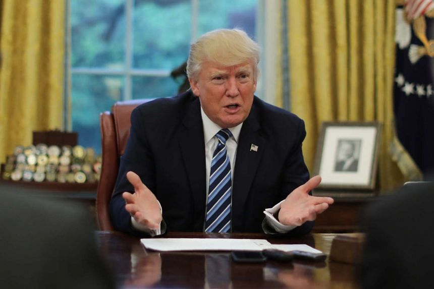 US President Donald Trump speaks during an interview with Reuters in the Oval Office of the White House.
