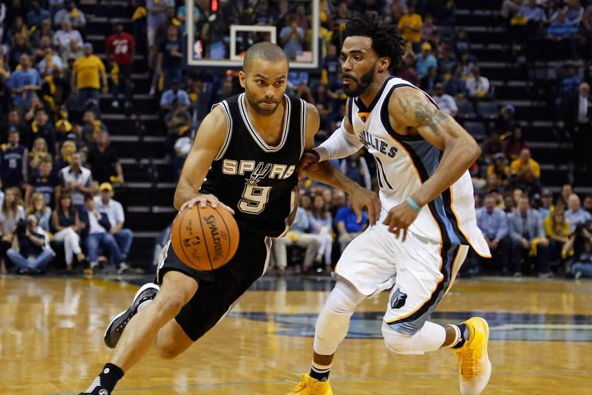 Tony Parker (left) of the San Antonio Spurs drives past Mike Conley of the Memphis Grizzlies during Game 6 of the Western Conference Quarterfinals during the 2017 NBA Playoffs at FedExForum in Memphis, Tennessee on April 27, 2017.