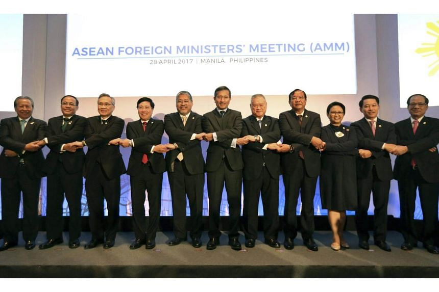 Asean Foreign Ministers and Secretary General Le Luong Minh pose for a family photo during the Asean Foreign Ministers Meeting (AMM).