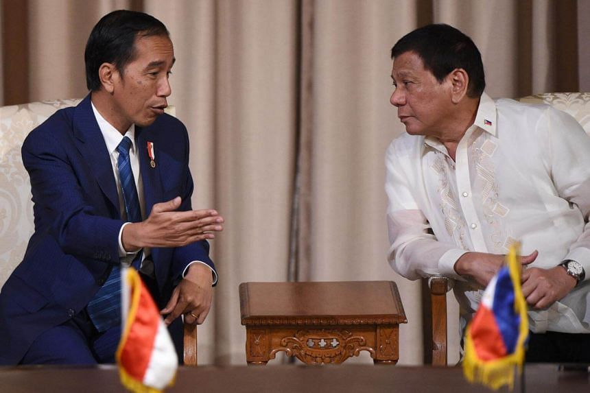 Indonesia's President Joko Widodo (left) with Philippines' President Rodrigo Duterte after their bilateral meeting in Manila on April 28, 2017, ahead of the Association of Southeast Asian Nations summit.