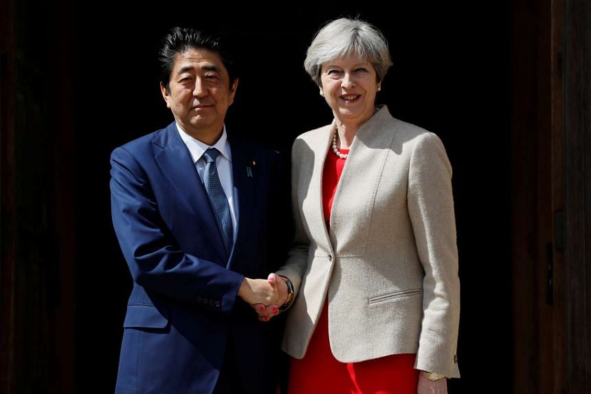 Britain's Prime Minister Theresa May greets Prime Minister Shinzo Abe of Japan during a visit to Chequers, April 28, 2017.