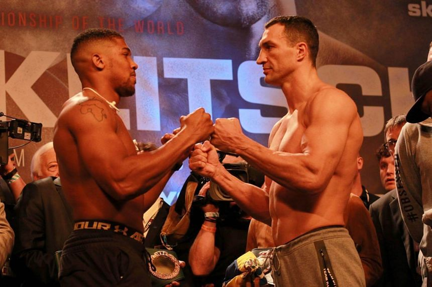 Britain's Anthony Joshua (left) and Wladimir Klitschko (right) of Ukraine pose during the weigh-in for their WBA Heavyweight Super Championship title bout at Wembley stadium, London, Britain on April 28, 2017.