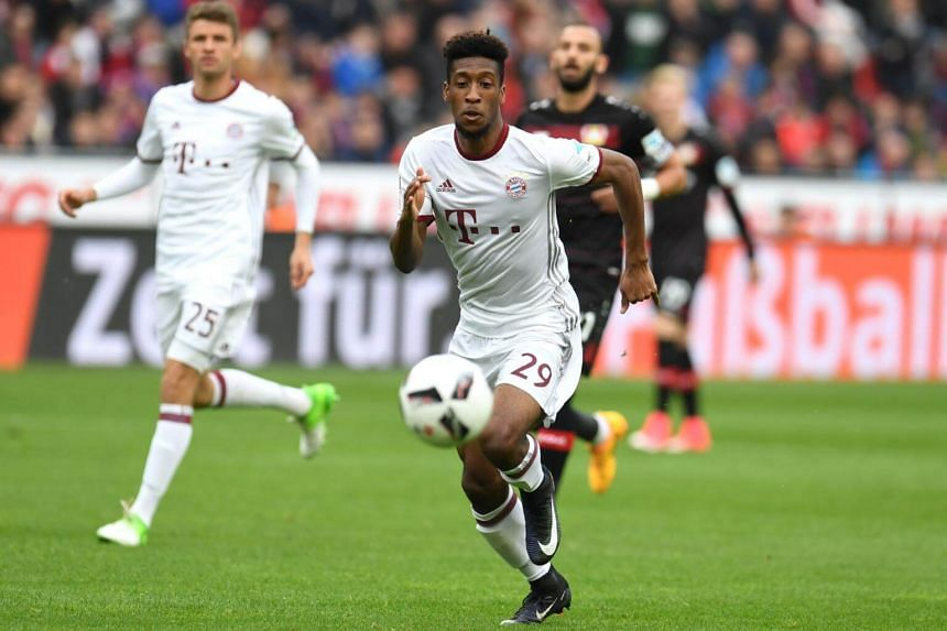 Bayern Munich's French forward Kingsley Coman vies for the ball during the German First division Bundesliga football match between Bayer 04 Leverkusen and FC Bayern Munich in Leverkusen, on April 15, 2017.