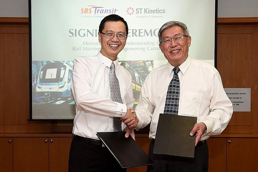 ST Kinetics president Lee Shiang Long (left) and SBS Transit chief executive officer Gan Juay Kiat at the memorandum of understanding signing ceremony on Wednesday.
