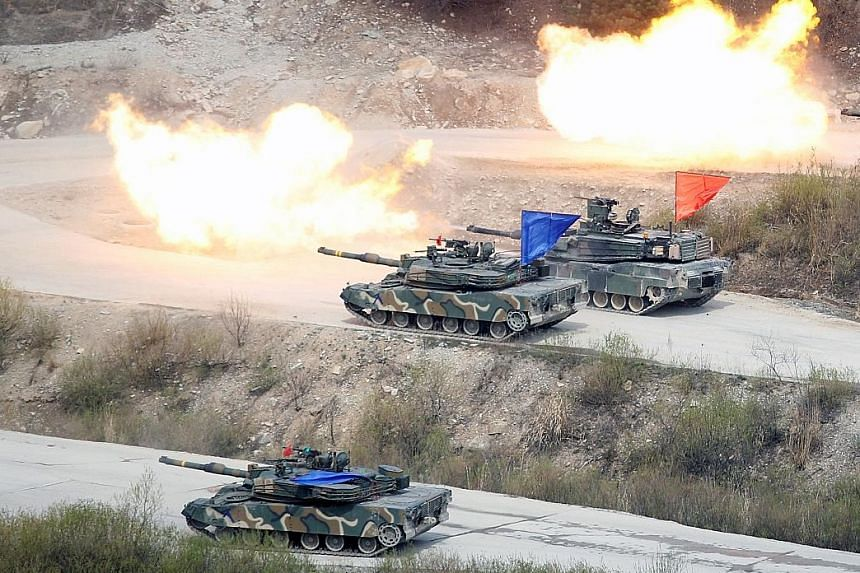 South Korean and US tanks in an exercise near the demilitarised zone in South Korea on April 21. As a middle power, South Korea cannot afford to alienate either China or the US, or even Japan. Militarily, it still depends on the US.