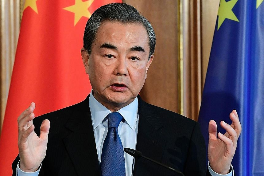 Chinese Foreign Minister Wang Yi, during a visit to Germany on Wednesday, points out that his country's businesses and citizens have spread around the world.