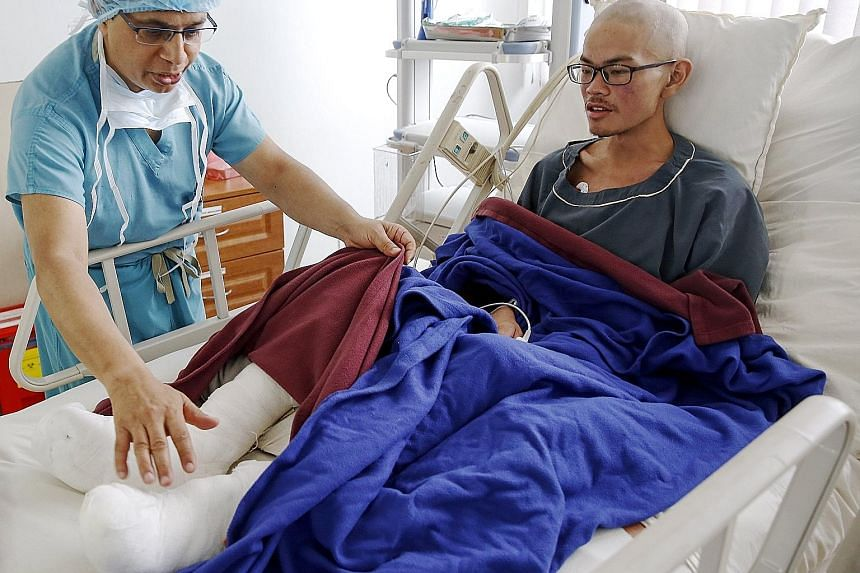 Rescued Taiwanese trekker Liang Sheng-yueh, who lost 30kg after being stranded for 47 days with his girlfriend on a mountainside in north-west Nepal, being checked by Dr Chakra Raj Pandey at Grande International Hospital in Kathmandu.