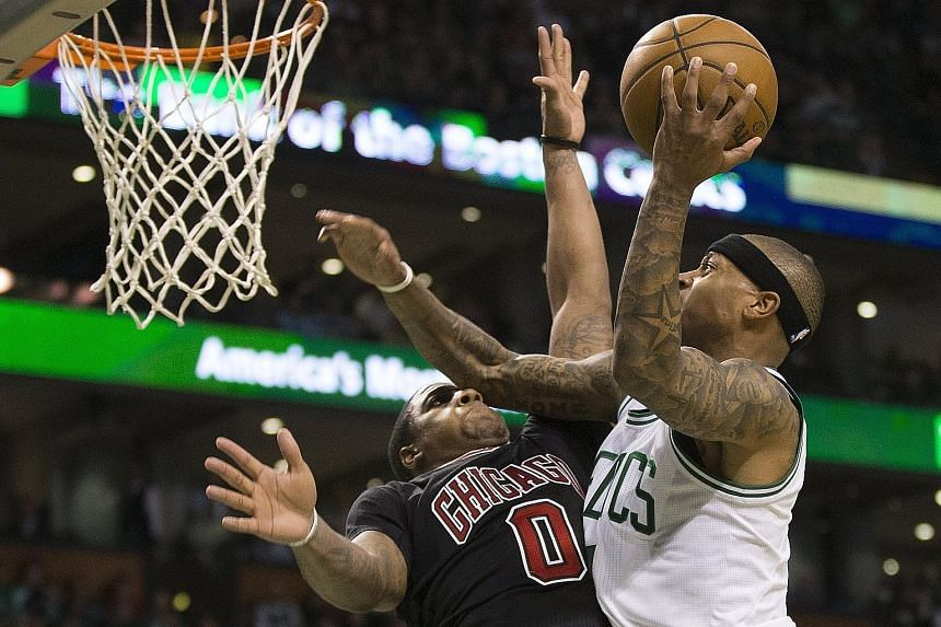 Boston Celtics guard Isaiah Thomas scoring against Isaiah Canaan of the Chicago Bulls during the vital run in the fourth quarter to win 108-97. Thomas, who had 24 points in the game, scored 11 of them in the last quarter to put the outcome beyond dou